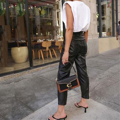 shoulder pad t shirt woman wearing thong flip flop heels